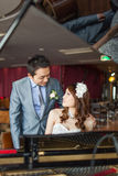 Bride is playing piano Royalty Free Stock Image