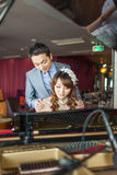 Bride is playing piano Stock Photos