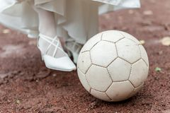 Bride playing soccer with ball stock images