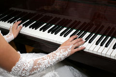 Bride plays the piano closeup Royalty Free Stock Image