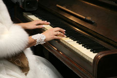Bride plays the piano closeup Stock Photography