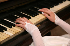 Bride plays the piano closeup Stock Images