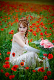 Bride among poppies Royalty Free Stock Image
