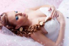 Bride portrait. Beautiful blond bride portrait in studio stock photos