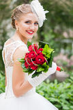Bride portrait with bouqet. Bride portrait with hairstyling and bouqet outdoors Stock Photo