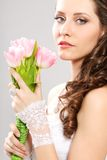 Bride portrait with bouquet of tulips Stock Photo