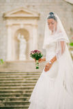 Bride portrait with bouquet and veil Stock Images