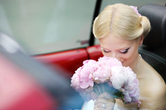 Bride portrait in a car Stock Photography