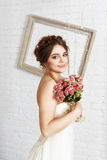Bride portrait in champagne wedding dress. Wedding dress fashion. Beautiful young bride portrait in vintage, shabby chic wedding dress with bridal bouquet. Girl Royalty Free Stock Photography
