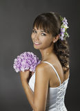 Bride Portrait with Flowers Bouquet, Wedding Hairstyle Makeup Royalty Free Stock Photo
