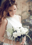 Bride portrait. Girl with wedding bouquet of white Royalty Free Stock Images