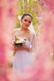 Bride portrait over pink cherry trees outdoor Royalty Free Stock Photos