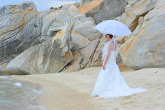 Bride portrait by the sea shore Stock Photo