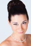 Bride portrait in studio. Beautiful young brunette bride portrait in studio Stock Images