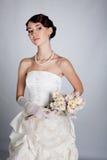 Bride portrait in studio. Beautiful young bride portrait in weddeing dress Stock Image