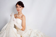 Bride portrait in studio. Beautiful young bride portrait in weddeing dress Royalty Free Stock Photography
