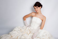 Bride portrait in studio. Beautiful young bride portrait in weddeing dress Royalty Free Stock Images