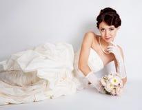 Bride portrait in studio. Beautiful young bride portrait in weddeing dress Stock Photos