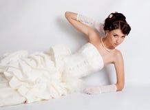 Bride portrait in studio. Beautiful young bride portrait in weddeing dress Royalty Free Stock Photo