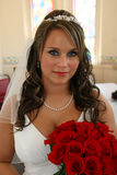 Bride Portrait Before Wedding. Bride before wedding smiling with red roses Stock Photo