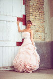 Bride portrait. Young beautiful bride portrait in elegant wedding dress in front of  an old abandoned building Royalty Free Stock Image