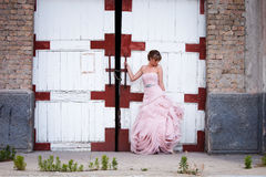 Bride portrait. Young beautiful bride portrait in elegant wedding dress in front of  an old abandoned building Royalty Free Stock Photos