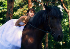Bride poses on a horse Royalty Free Stock Image