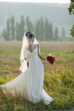 Bride poses outdoors Royalty Free Stock Photo