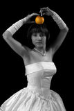 Bride posing with apple. Image of a bride posing with apple Stock Image