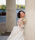 Bride posing at column. A beautifuk bride poses at column Stock Images