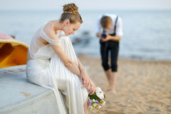 Bride posing for her groom Stock Photos