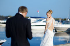 Bride posing for her groom Royalty Free Stock Photos