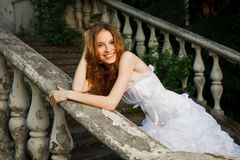 Bride posing on old stairs Royalty Free Stock Photos