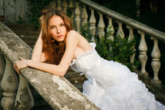 Bride posing on old stairs Stock Photo