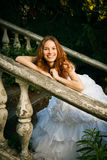 Bride posing on old stairs Royalty Free Stock Photo