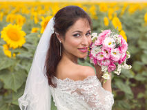 Bride posing in a sunflower field Royalty Free Stock Photography