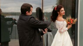 The bride posing to photographer stock video footage