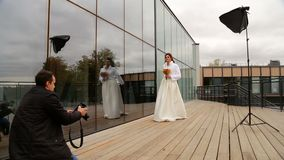 The bride posing to photographer stock footage