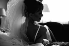 Bride is posing  in whiteness on the background  bed Stock Photo