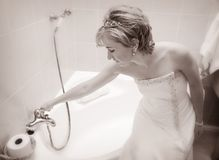 Bride preparing a bath Royalty Free Stock Photography