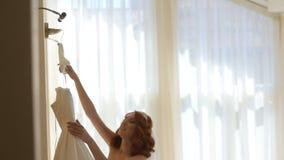 Bride preparing for dressing dresses stock video footage
