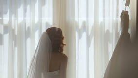 Bride preparing for dressing dresses stock video