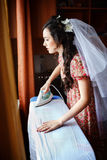 The bride preparing for wedding ceremony, ironing Stock Photo