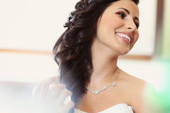 Bride preparing for wedding makeup stock photo