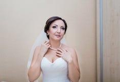 Bride preparing for wedding Stock Photos