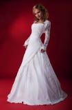 Bride pretty female in wedding dress. Stock Photos