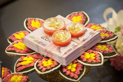 Bride price money and gold in traditional wedding ceremony Thail Stock Images