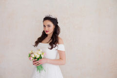 Bride Princess stands in a wedding dress with flowers. Bride Princess stands in a wedding dress with a bouquet of flowers stock images
