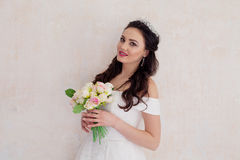 Bride Princess stands in a wedding dress with flowers. Bride Princess stands in a wedding dress with a bouquet of flowers Stock Photography