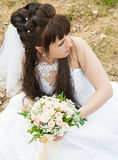 Bride in a profile. Bride with a bunch of flowers, in a wedding dress Stock Photo